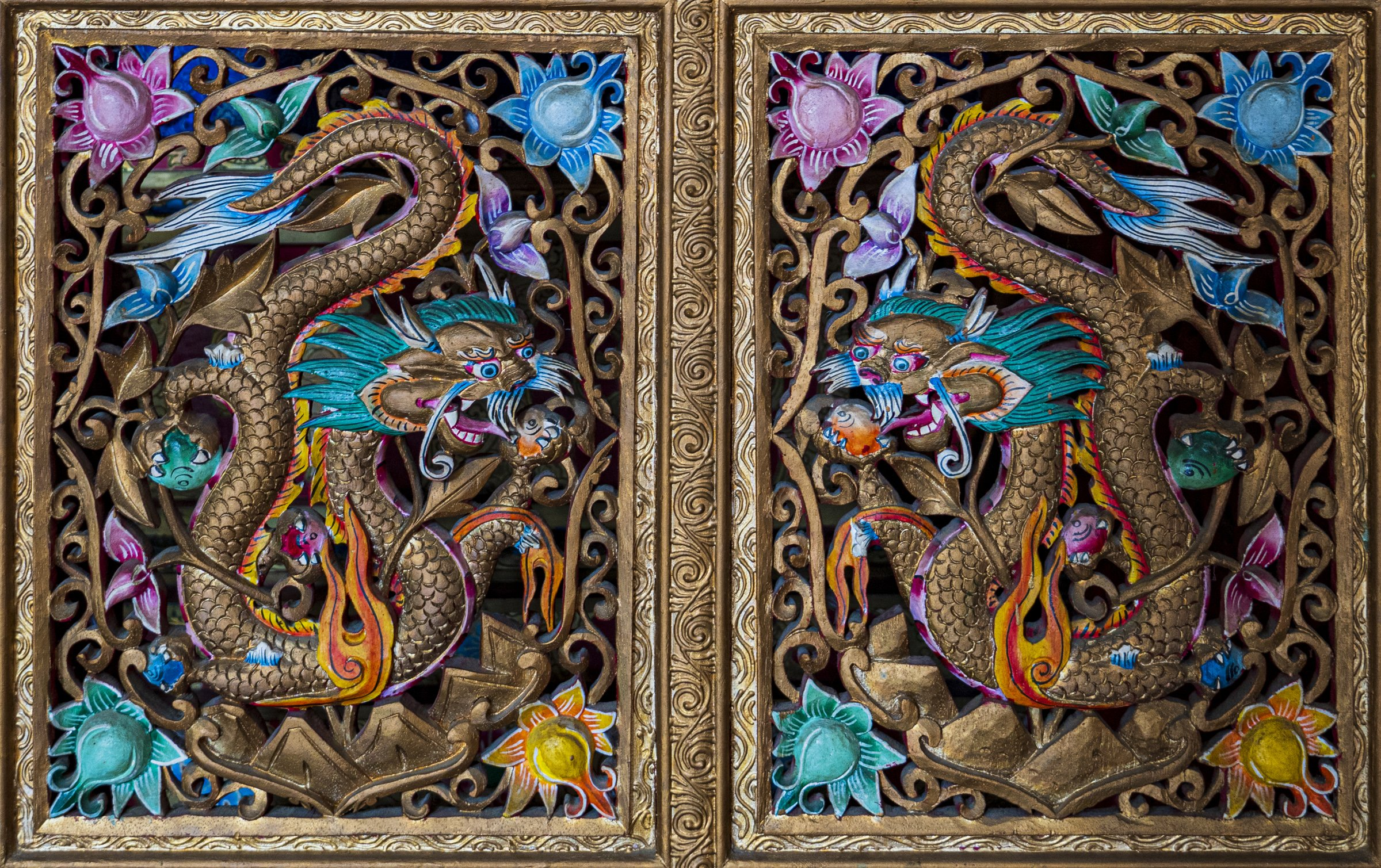 Wood sculpture of twin dragons